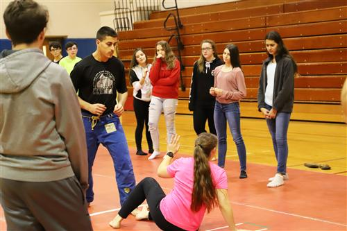 Students practicing self-defense