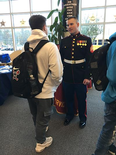Student talking with military rep