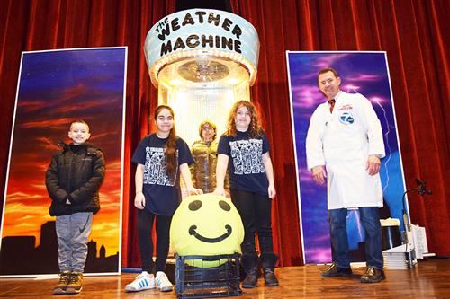 Students and Andy Parker standing in front of Weather Machine
