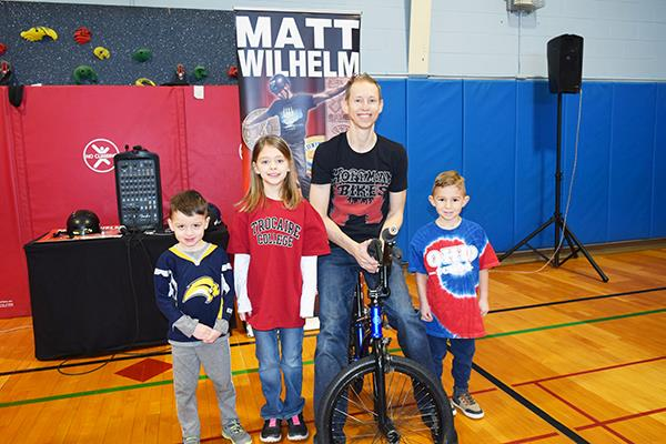 BMX biker with students