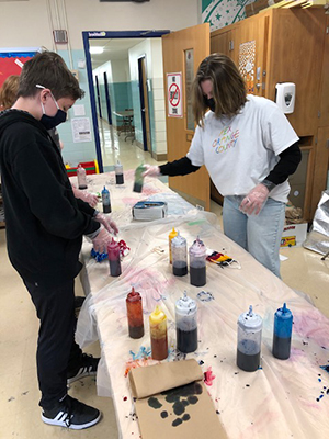 Students using tie-dye