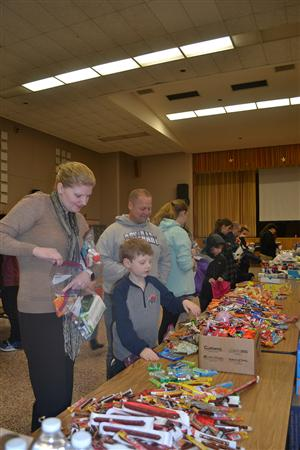 Volunteers packing backpacks