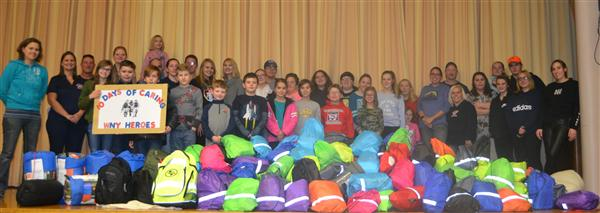 Students and teachers with backpacks