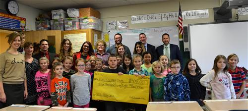 Photo of Mrs. Jafarjian's Class giving check to Kids Escaping Drugs